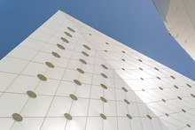 Modern White Building Against A Blue Sky