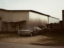Vintage Classic Car Abandoned Under Tarp Next To Garage