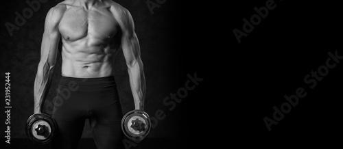 Fotografie, Obraz  Fitness muscular body on dark background