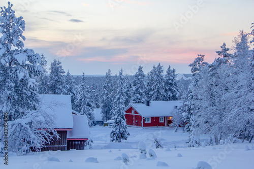 Fotografie, Obraz  Winter landscape scenery in Lapland, Scandinavia with snow and traditional house