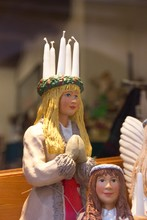 Swedish Christmas Figure With Candle Crown On The Head Of Saint Lucia, A Christian Martyr That Is Celebrated On 13th Of December In Scandinavian Countries