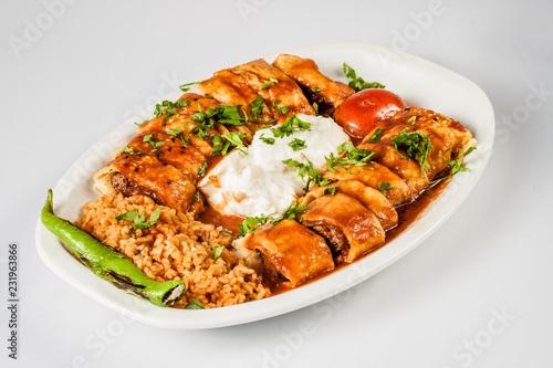 Turkish Beyti Kebab Served with Bulgur Pilaf and Yoghurt