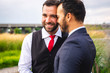 canvas print picture - A Handsome gay male couple in the park on their wedding day