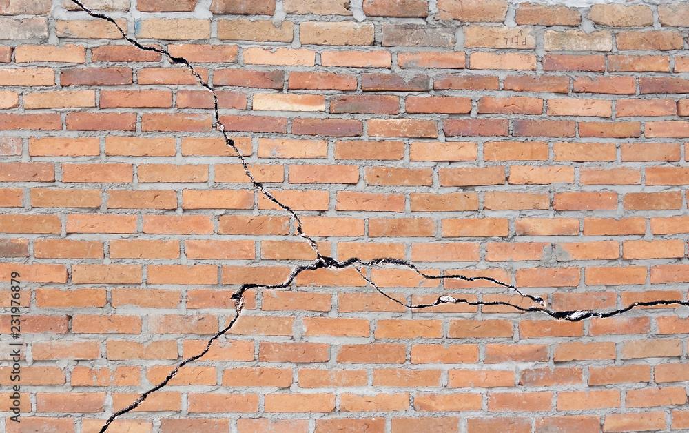 Fototapeta Cracked brick foundation