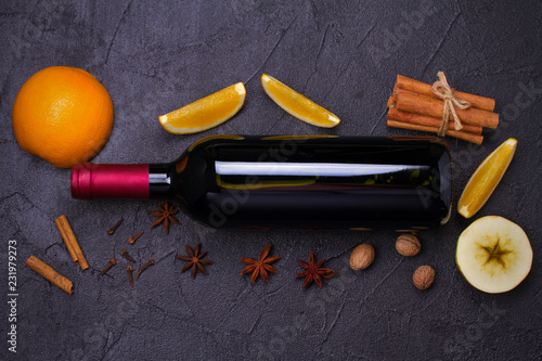 Spoed Foto op Canvas Cocktail Bottle of red wine with spices, citrus fruits and apples for mulled wine hot drink. top view, horizontal
