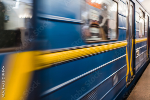 Stampa su Tela Kyiv underground metropolitan train in motion blur, moving with passengers