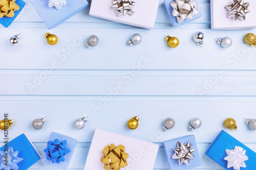 Fototapety, obrazy: Gift boxes and small Christmas balls lie on a light background. Gifts decorated with bows.