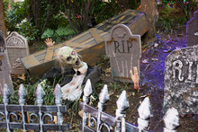 Halloween Decoration Made With Tombstones In A Garden During Halloween Celebration At Night In Georgetown.