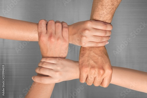 Fototapety, obrazy: Group of people stacking hands together