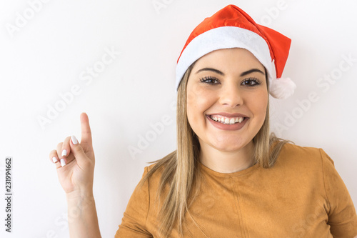 Photo  Brazilian woman smiling with christmas hat on white background