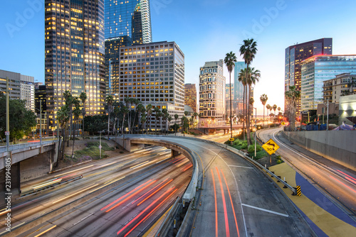 Downtown Los Angeles at sunset with car traffic light trails