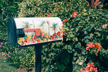 Floral Mailbox With Polynesian Flowers As Background