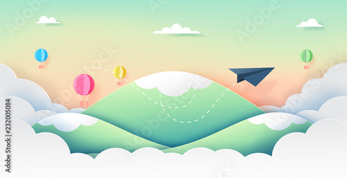 Paper airplane and hot air balloons flying on mountains,clouds and beautiful sky paper art style.Vector illustration.