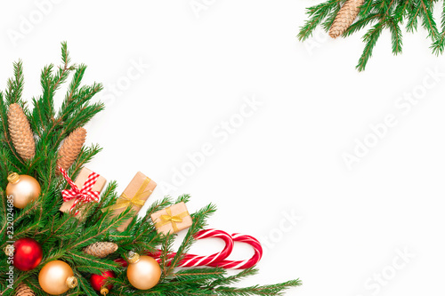 Stampa su Tela Christmas frame composition with gift box, pine cones, fir tree branches, isolated