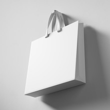 On The Wall Hangs A White Shopping Bag, Side View. 3d Rendering Mock Up