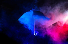 Abstract Concept - Blue Umbrella Among Colorful Dust Clouds
