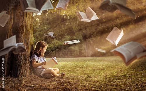 Cheerful child reading an interesting book