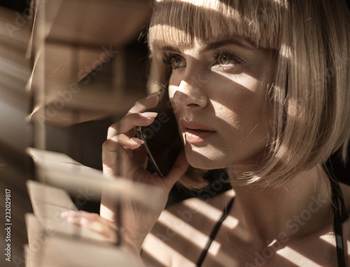 Closeup portrait of a calm woman talking on the phone