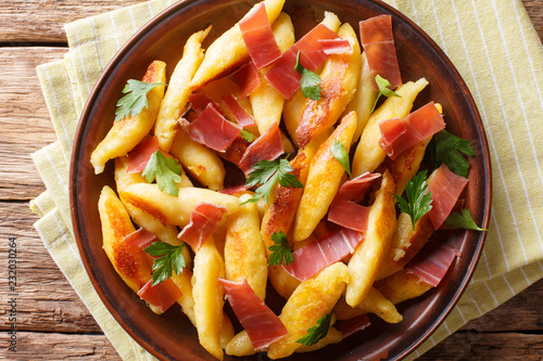 German delicious potato schupfnudeln with ham and herbs close-up. horizontal top view