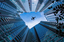 The Plane Is Flying Over Skyskrapers