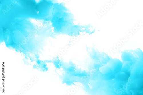 Blue ink splashes in the water. Abstract background