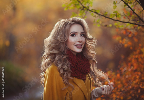 17e9835c6f Beautiful autumn portrait of a young smiling mother. Young happy woman in autumn  clothes walking