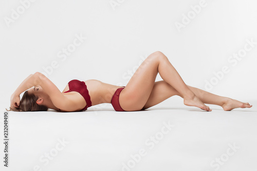 Perfect body young woman on a white background in sexy lingerie