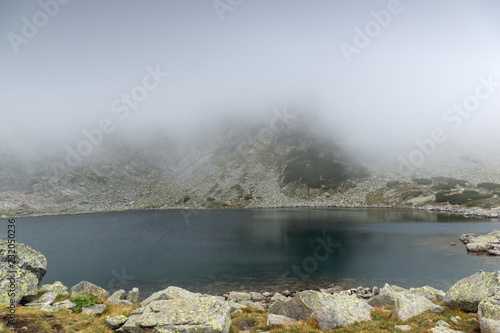 Poster Donkergrijs Amazing Landscape with fog over Musalenski lakes, Rila mountain, Bulgaria