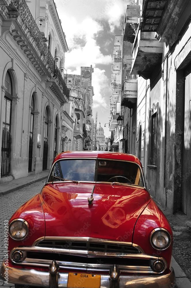 Fototapeta Retro car red and black-white photo of the old Havana street. Cuba. artistic photo.