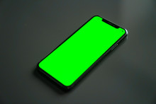 IPhone X, Green Screen On A Gray Background