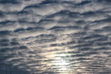 Textured Clouds In The Blue Sky