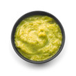 Tasty green sauce in bowl on white background