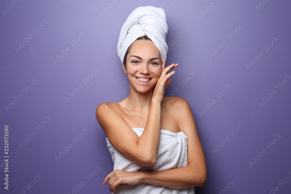 Fototapety, obrazy: Beautiful young woman wrapped in towel on color background