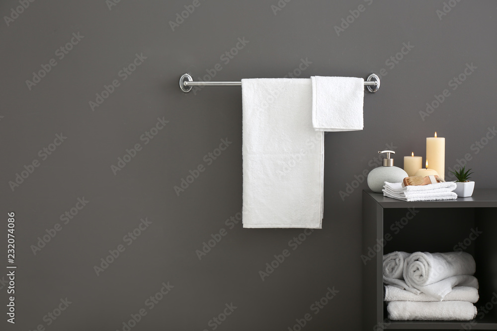 Fototapeta White bath towels near grey wall