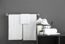White Bath Towels Near Grey Wall