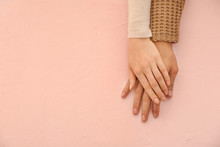 Hands Of Loving Young Couple On Color Background