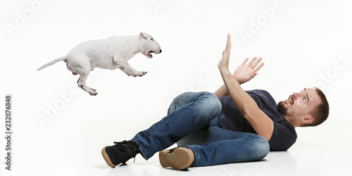 Valokuva  Emotional Portrait of scared man and his dog, concept of friendship and care of man and animal