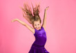 Leinwandbild Motiv Ballroom latin dance hairstyles. Kid girl with long hair wear dress on pink background. Things you need know about ballroom dance hairstyle. Hairstyle for dancer. How to make tidy hairstyle for kid