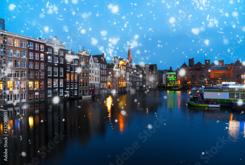 Photo  Houses over canal with mirror reflections at blue night with snow, Amstardam, Ne