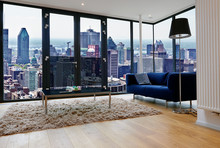 Modern Living Room With Large Windows And View On City Panorama