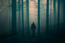 Man Walking Alone On Foggy Rur...