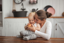 Mother Gives The Baby Apple, M...