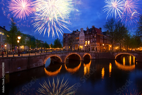 Spoed Foto op Canvas Historisch geb. famous canals and bridgres of Amsterdam in night with fireworks, Netherlands