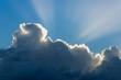 Leinwandbild Motiv Sun rays from thunderclouds