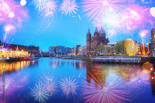 Foto op Aluminium Historisch geb. Amsterdam skyline with Church of St Nicholas over old town canal at night with fireworks, Amsterdam, Holland