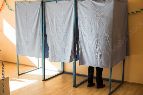 Fotografie, Obraz  Persons voting in booths at a polling station