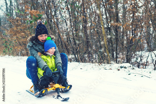 Christmas Vacation Sled.Happy Mother And Her Son Enjoying Sleigh Ride Happy Family