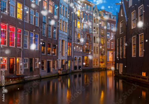 Foto op Aluminium Historisch geb. Illuminated houses over canal with reflections at night at winter, Amsterdam, Netherlands