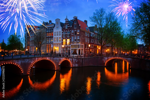 famous canals of Amsterdam with fireworks, the Netherlands Wallpaper Mural