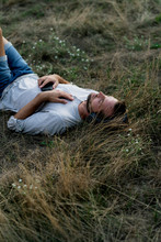 Relaxed Man Lying In Field Lis...